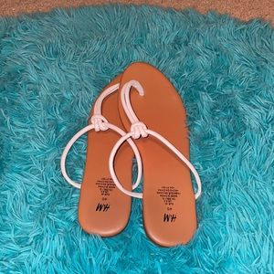 Brown and white sandals